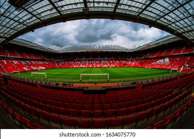 Manchester, England, UK - March 22, 2019 - Football field and Stand in Old Trafford, the home football stadium of Manchester United Team in Premier League