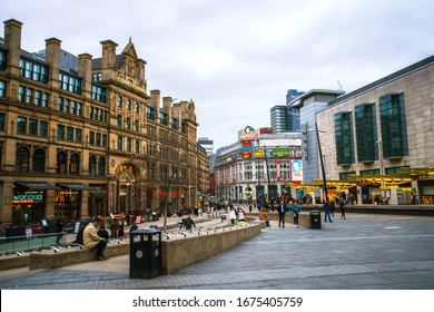 Manchester, England, UK - March 22, 2019 - Street view of Exchange Square, civic square and a major shopping area in Manchester