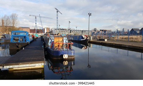 MANCHESTER, ENGLAND, UK - MARCH 30, 2016: CANAL, BARGES AND INDUSTRIAL SKYLINE IN MANCHESTER'S EASTLANDS