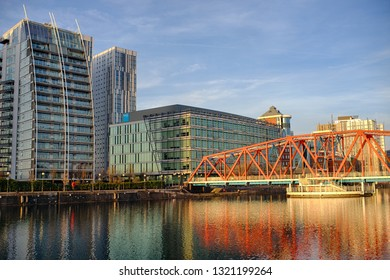 Manchester, England / United Kingdom - 21 February 2019:  View on the river bridge of Manchester Ship Canal in Salford and Trafford, MediaCityUK buildings and facilities.