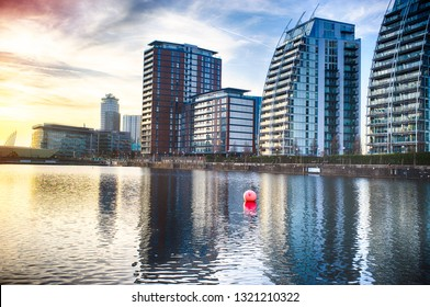Manchester, England / United Kingdom - 21 February 2019:  View to the Salford Quays, MediaCityUK modern buildings and facilities. Manchester Ship Canal in Salford and Trafford