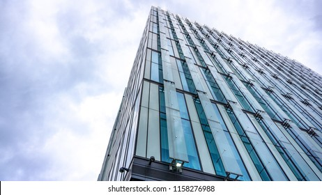 Manchester, England / United Kingdom - August 10 2018: Bureau gallery building.  The Spinningfields, Manchester city. The glass building up to the sky