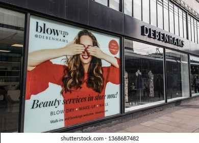 Manchester / Great Britain - March 23, 2019 : Debenhams shop window including display and advertisement.  Company signage and logo