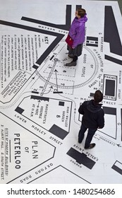 Manchester Greater Manchester UK August 16 2019  200th anniversary of Peterloo massacre aerial view map of the day  with man and woman studying