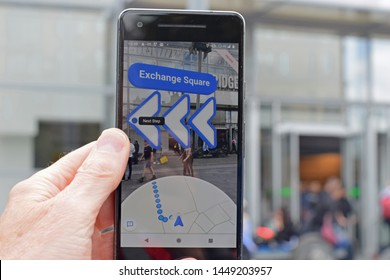 Manchester, Greater Manchester, UK. July 12, 2019. Google maps AI on Pixel 2 in directions mode. App is displaying shops and arrows with direction of travel. The next step is towards exchange square.