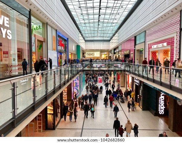 MANCHESTER - MARCH 10, 2018: Chain brand retail outlets across two levels at The Manchester Arndale shopping centre in Manchester, England, UK.