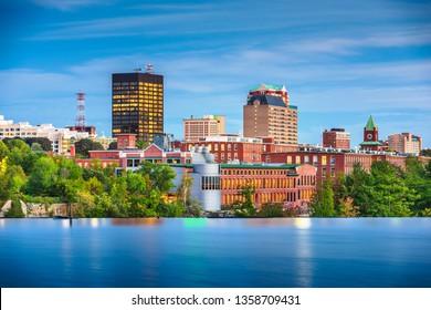 Manchester, New Hampshire, USA Skyline on the Merrimack River at dusk.
