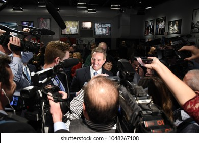 Manchester, N.H., USA, March 16, 2018. U.S. Sen. Jeff Flake, R-Ariz., talks with reporters after criticizing President Donald Trump during a speech at St. Anselm College's Institute of Politics.