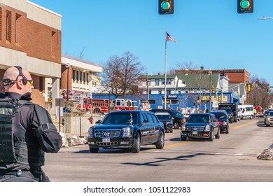 Manchester, NH/US - March 19, 2018:  Police officer watches as President Donald Trump's motorcade leaves fire station after giving speech on opioid epidemic.