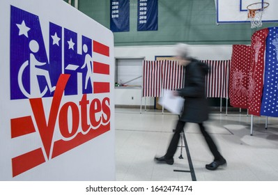 Manchester, N.H./USA - Feb. 11, 2020: An elderly woman votes in a school gym during the New Hampshire presidential primary.