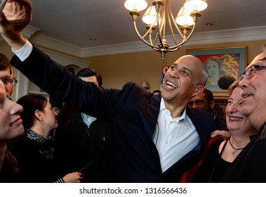 Manchester, N.H./USA - Feb. 17, 2019: U.S. Senator Corey Booker, D-N.J., takes a selfie with guests at a house party during his first visit to New Hampshire as a presidential candidate.