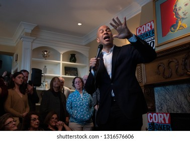 Manchester, N.H./USA - Feb. 17, 2019: U.S. Sen. Corey Booker, D-N.J., talks to voters at a house party on his first weekend in New Hampshire as a presidential candidate.