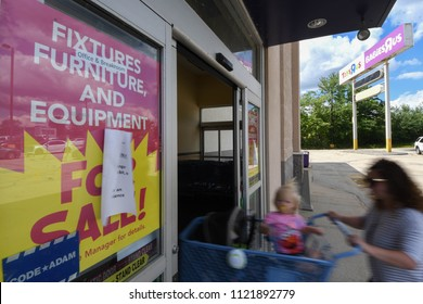 Manchester, N.H./USA - June 25, 2018: A mother and child enter Toys R Us to seek bargains during its liquidation sale.