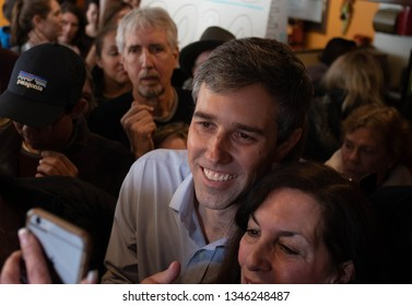 Manchester, N.H./USA - March 21, 2019: Beto O'Rourke poses for a selfie with a voter during a campaign stop at a Mexican restaurant.