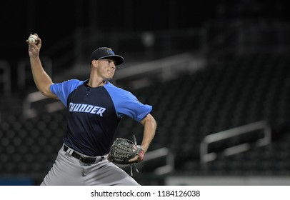 Manchester, N.H.,/USA - Sept. 5, 2018: Trenton Thunder pitcher Brian Keller pitches in a nearly empty stadium during a playoff game against the N.H. Fisher Cats.