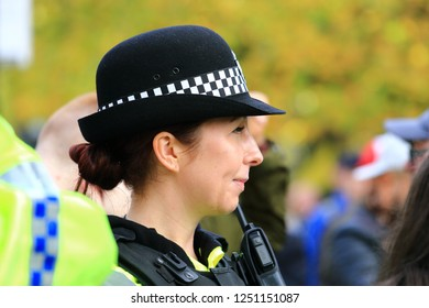 Manchester Piccadilly Gardens UK 10.20.18 A WPC looks on as EDL (English Defence League) members confront protesters at a Stand Up To Racism demonstration.