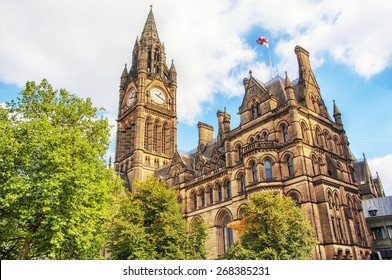 Manchester Town Hall, UK with cloudy sky