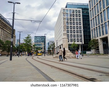Manchester, UK 05/27/2017 MetroLink trams travelling through St Peters Square Manchester