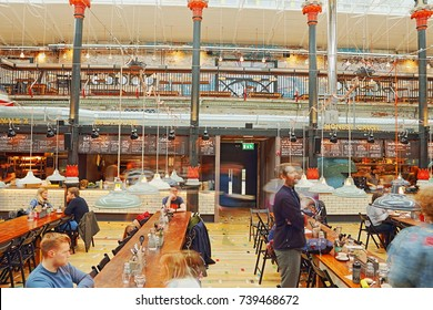 Manchester, UK - 22 October, 2017: Mackie Mayor Market is built on the site of a  former meat market and is a new dining destination.