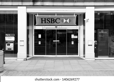 MANCHESTER, UK - APRIL 21, 2013: Exterior view of HSBC Bank branch in Manchester, UK. HSBC is one of largest bank groups, holding assets of $2.69 trillion worldwide (2012).