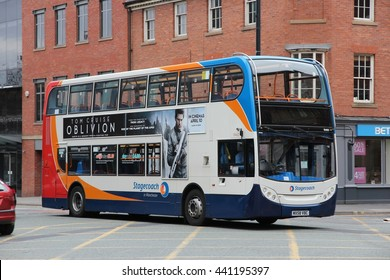 MANCHESTER, UK - APRIL 21, 2013: People ride Stagecoach city bus in Manchester, UK. Stagecoach Group has 16 percent bus market in the UK. Stagecoach UK employs 18,000 people.