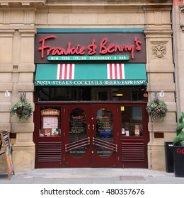 MANCHESTER, UK - APRIL 21, 2013: Frankie & Benny's restaurant on April 21, 2013 in Manchester, UK. Frankie & Benny's is an Italian-American style restaurant chain with 200+ locations in the UK.