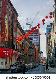 MANCHESTER, UK - APRIL 21, 2016 : Streets of Chinatown, Manchester. It is the second largest Chinatown in the United Kingdom and the third largest in Europe.