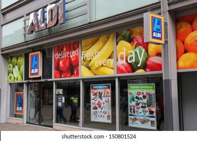 MANCHESTER, UK - APRIL 21: People visit Aldi supermarket on April 21, 2013 in Manchester, UK. Aldi is one of largest global discount supermarket chains with 9,221 locations.