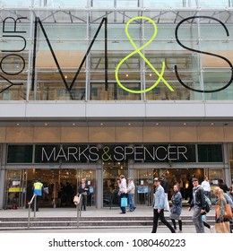 MANCHESTER, UK - APRIL 22, 2013: People visit Marks & Spencer on April 22, 2013 in Manchester, UK. M&S is a major retailer with 1,010 stores in 41 countries. It specializes in fashion and luxury goods