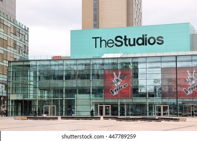 MANCHESTER, UK - APRIL 22, 2013: People visit Studios MediaCityUK in Manchester, UK. MediaCityUK is a 200-acre development completed in 2011, used by BBC, ITV and other companies.