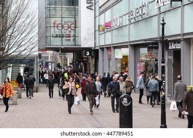 MANCHESTER, UK - APRIL 22, 2013: People visit shopping area in Manchester, UK. Greater Manchester is the 3rd most populous urban area in the UK (2.2 million people).
