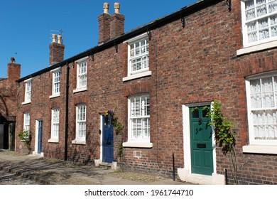 Manchester, UK. April 22, 2021. Row of terraced houses, Moravian settlement, Brethren Street, Droylesdon.