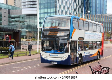 MANCHESTER, UK - APRIL 22: People ride Stagecoach city bus on April 22, 2013 in Manchester, UK. Stagecoach Group has 16% bus market in the UK. Stagecoach UK employs 18,000 people.