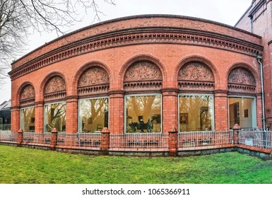 MANCHESTER, UK - APRIL 8, 2018: The facade of the Whitworth Art Gallery facing onto Whitworth Park. The gallery is located in Whitworth Park and is part of the University of Manchester.