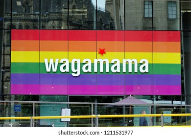 MANCHESTER, UK - AUGUST 10, 2018: The colorful logo above the entrance to the Wagamama restaurant in Manchester city centre, a British restaurant chain, serving Asian food.
