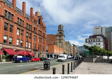 MANCHESTER, UK - AUGUST 10,2018: Old red brick Victorian and Edwardian buildings on Peter street in Manchester's city center on an overcast day.