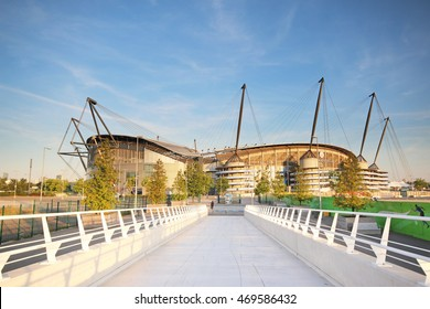MANCHESTER, UK - AUGUST 14, 2016:View of the Etihad stadium from the Campus bridge which is home to Manchester City English Premier League football club, one of the most successful clubs in England.
