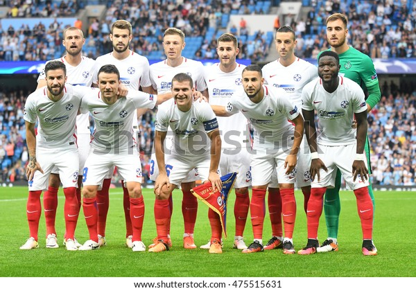 MANCHESTER, UK - AUGUST 24, 2016: Steaua's line up posing prior to the UEFA Champions League play-off game between Manchester City and Steaua Bucharest at Etihad stadium.