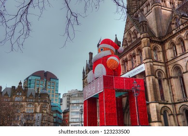 MANCHESTER, UK - DECEMBER 29: Historic Manchester Town Hall Designed by architect Alfred Waterhouse decorated for festive season with a figure of Father Christmas.  Manchester December 29, 2012.