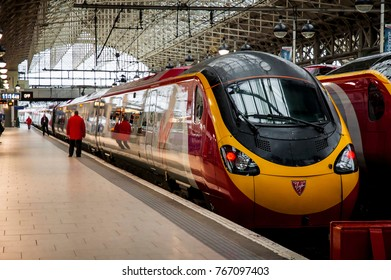 MANCHESTER, UK - FEB 5, 2014: Virgin Trains West Coast Class 390 Pendolino train stopping at platform of Manchester Railway Station