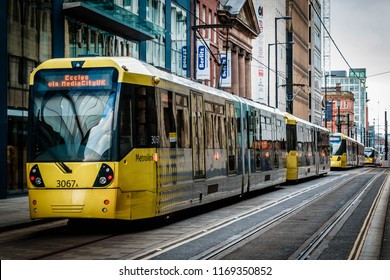 Manchester, UK - February 1 2016: Trams traveling down Mosley Street, Manchester City Centre