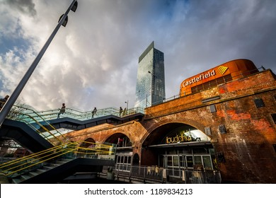 Manchester, UK - February 1 2016: View of Deansgate Locks and Deansgate-Castlefield Metrolink station with the Beetham Tower/Hilton hotel in the background