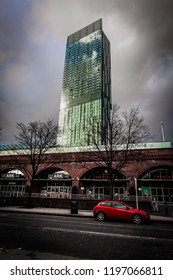Manchester, UK - February 1 2016: Street view of Deansgate-Castlefield Metrolink station with the Beetham Tower/Hilton hotel in the background with dark colours
