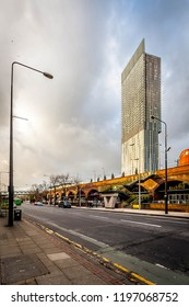 Manchester, UK - February 1 2016: Street view of Deansgate-Castlefield Metrolink station with the Beetham Tower/Hilton hotel in the background