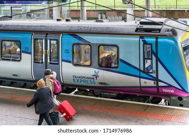 Manchester, UK - February 19 2020: UK airport train stopped at station. Transpennine Express at MAN airport terminal area rail track platform.