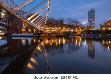 Manchester, UK - January 20th, 2018. Manchester's tallest building, Beetham Tower, reflected in the canals. Castlefield is an inner city conservation area of Manchester in North West England.