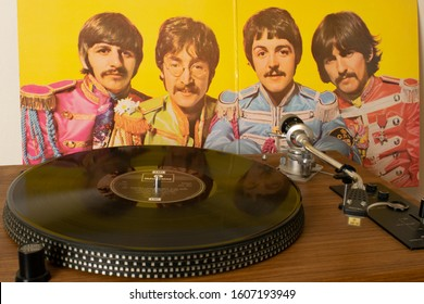 Manchester UK. January 6, 2020. Playing Sgt Pepper's Lonely Hearts Club Band vinyl record by the Beatles on a direct drive record player. Inner cover with photograph of the Beatles