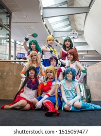 Manchester, UK - July 27, 2019: Cosplayers dressed as characters from the anime Sailor Moon at Manchester MCM Comic Convention.