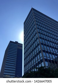 Manchester / UK - July 3 2015: Low angle view against blue sky of office towers in Manchester UK