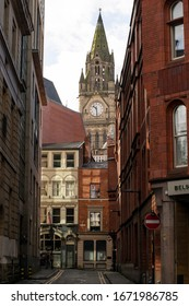 Manchester UK, March 13, 2020. Manchester Town hall clock tower above Tib Lane